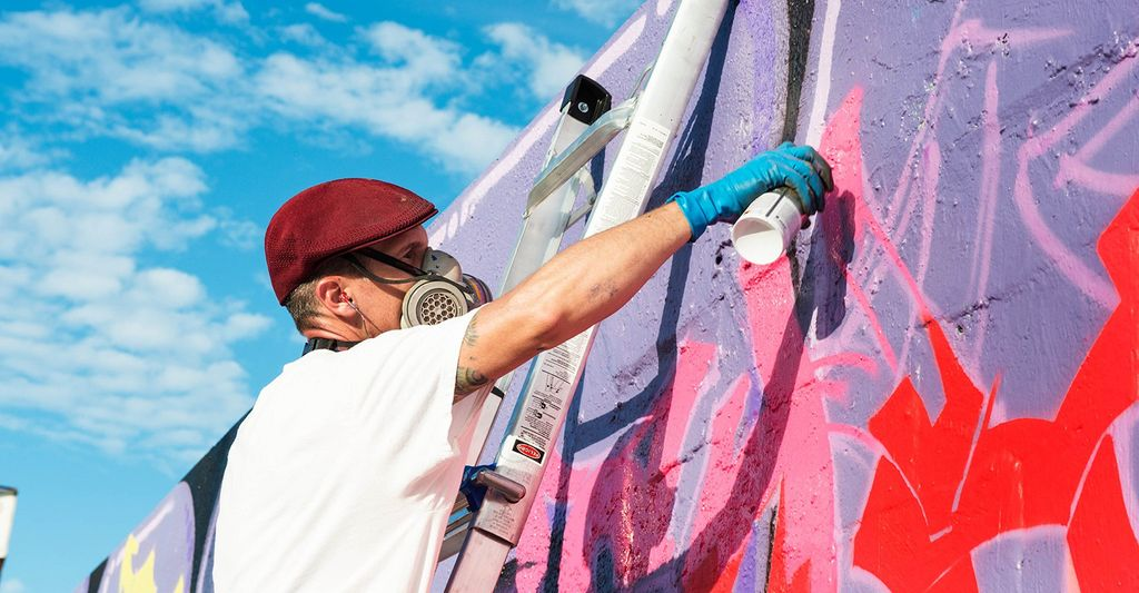 A mural painter in Washington, DC