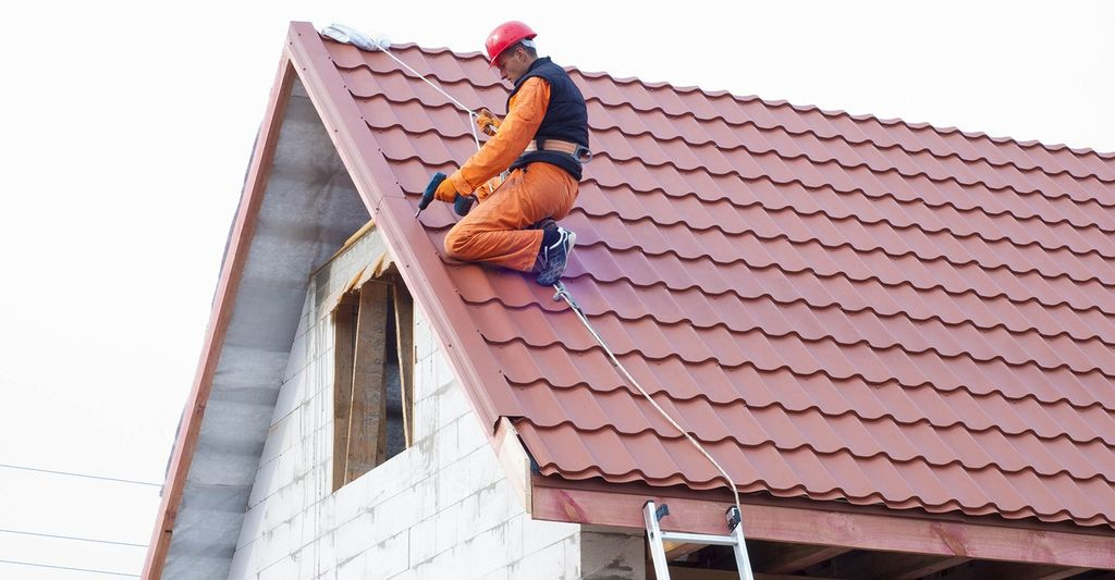 A tile roofing repair professional in Denver, CO