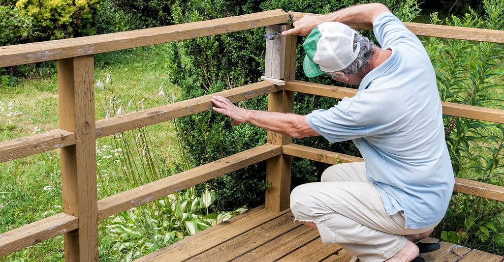 A wood stairs and railings repair professional in Denver, CO