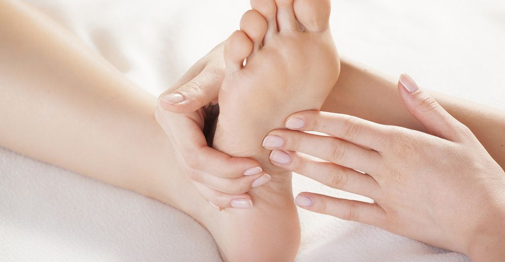 A foot massage therapist in Logan Square, IL