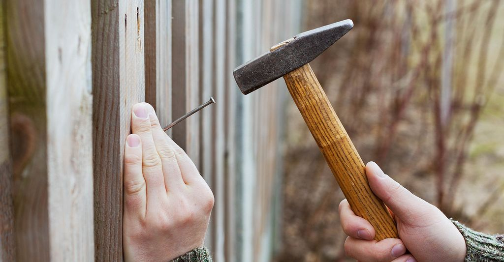 A fence repair professional in Aurora, CO