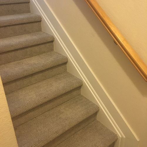 Trim installed to close gap between stair stringer and base-board.
