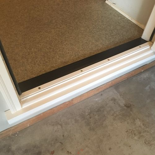 New threshold and weather stripping.