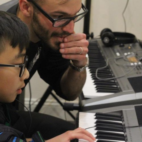 Josh Ross, our lead instructor, works with a piano student