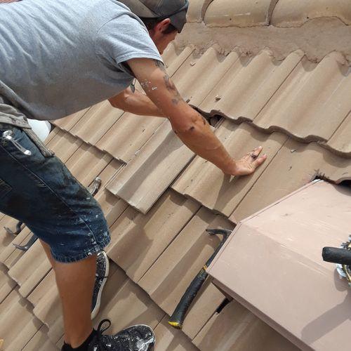Tile roof repair (loose or wind lifted tiles.
