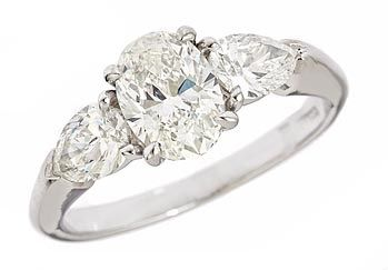 Brilliantly Cut Oval diamond paired with Pear shaped diamonds- How Perfect!