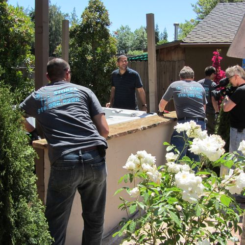 Mike Stokes & Mike Manalo installing a bar top onsite for Yard Crashers.