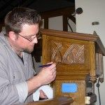 Applying shellac at Fort Snelling Chapel