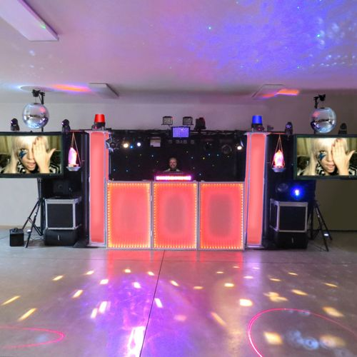 """This is my pride and joy Big System. This system is $1,500 for a show up to 6 hours long.   It's so big at 24 feet in width it's not all displayed in this picture because it cut off the dual 20"""" mirror balls, the dual 55"""" LED TVs and dual Bose subs.  You also get 20 uplights for around the room and 2 hours of video recorded to a DVD of the highlights of your party."""