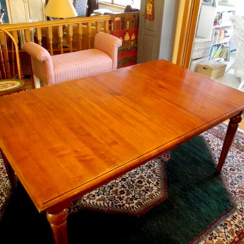 Table was restored by repairing damaged area, adding finish and rubbing out the entire top to match the repair
