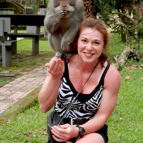 Me in Bali feeding a monkey at the monkey forrest.