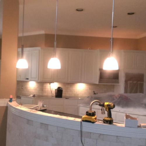 A new residential construction project in Katy. Bar lights, chandeliers, under cabinet lights, pool etc.