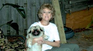 This is Nanette with one of her clients a Pekingese named Charlie. Charlie loves to be held and sleeps on Nanette's lap while his parents are away.