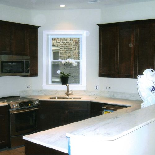 This is a small but very beautiful custom kitchen!! Imported white marble, stainless steel appliances, custom cabinets, crown moulding, imported hardwood flooring & more! Gorgeous...
