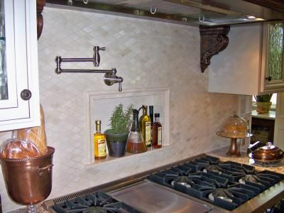 Tile kitchen backsplash with pot faucet and product niche