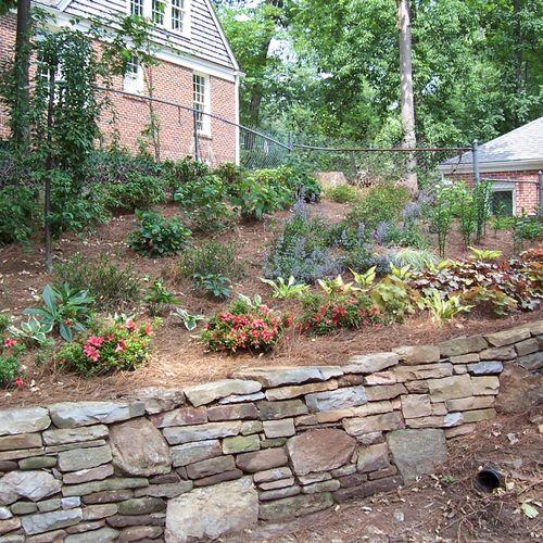 shade garden w/stacked stone wall
