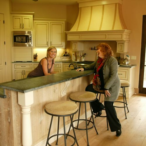 With client, Christine Kirks, in the kitchen of her custom home. (Counters and sink are soapstone.)