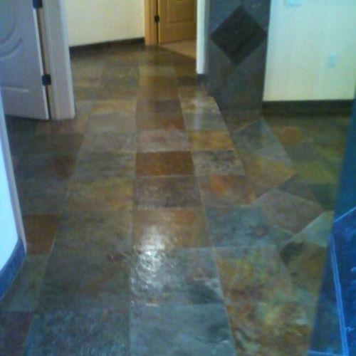 Slate tile, cleaned and coated.