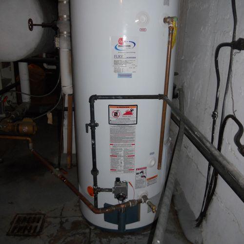 New 75 gallon Rheem gas hot water heater.