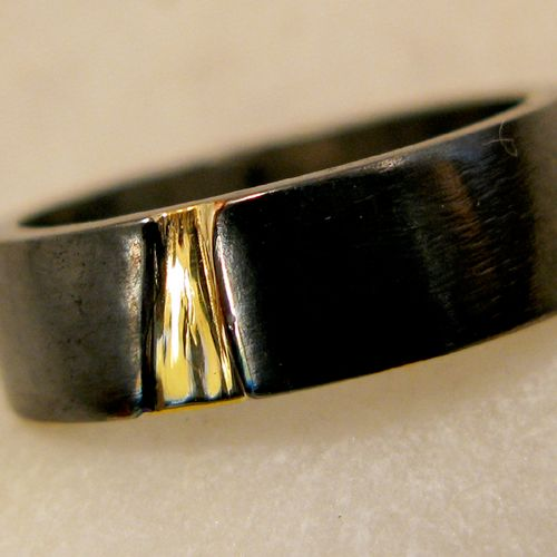 Gold crack ring.  18K gold within a crack on a ring made of an oxidized Japanese alloy: Shakudo