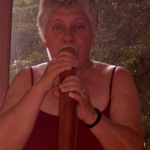 Elise playing eucalyptus didgeridoo