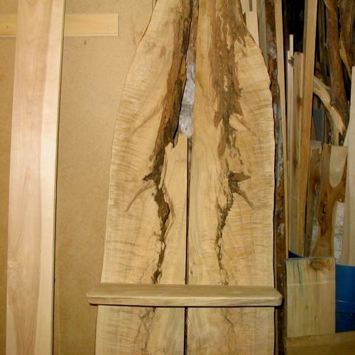 Book matched white oak slabs with 3 shelves.