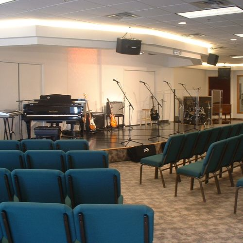 The Performance Hall / recording studio with sound system, lights. grand piano, drums and amps