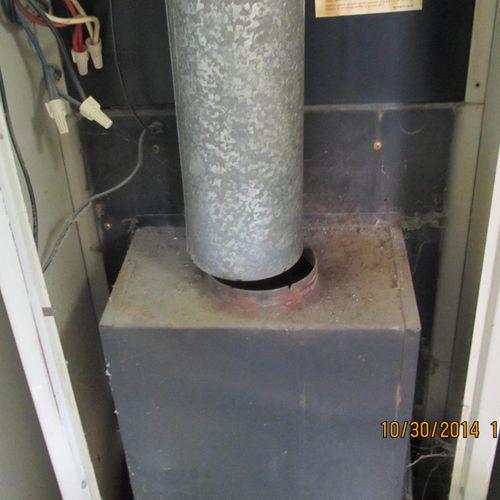 Disconnected furnace vent flue - a deadly carbon monoxide hazard.