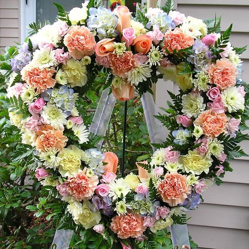 Mixed flowers & roses, &  hydrangeas in a Sympathy heart wreath.  Sent to a funeral We deliver to all funeral homes in Tacoma area as well as Hill Funeral Home & Powers Funeral Home in Puyallup,.  Also to Firlane in Spanaway