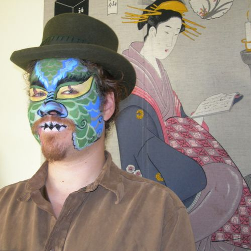 This Japanese style dragon was painted by Yenna, one of my very talented face painters.