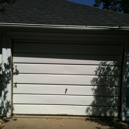 Here is a higher end home in an older neighborhood.  The owner wanted to upgrade to a nicer looking door for a cheaper price. This is the picture of the older garage door.