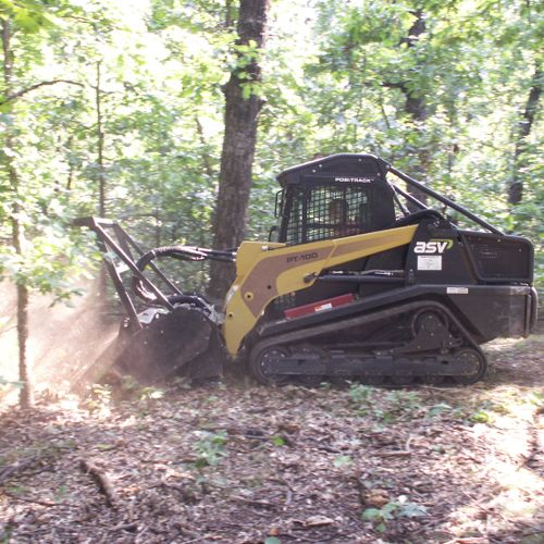 grinding fallen trees, limbs and scrub brush into mulch.