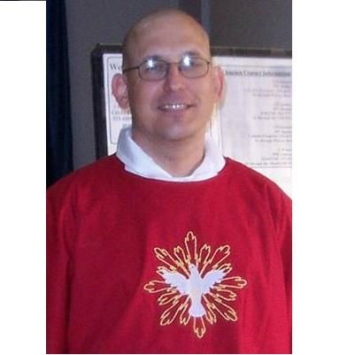 Fr. Jonathan wearing his Pentecost chasuble with the Dove with Rays design from Stitched With Grace.
