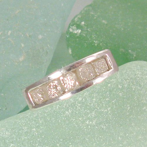 5 diamonds in the rough in channel setting in Sterling silver