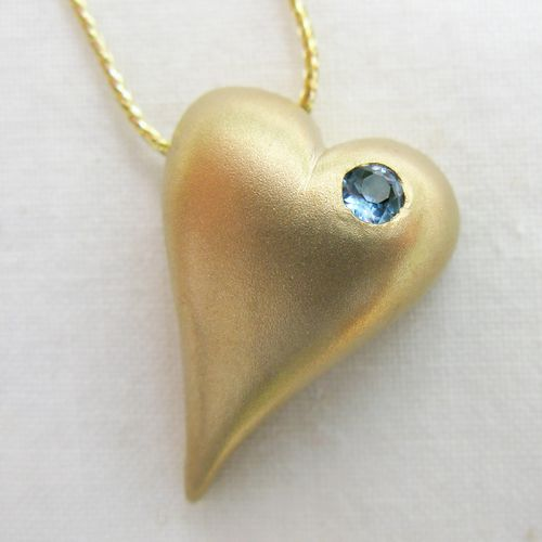 Heart in gold (14K) with aquamarine gem on a 14K gold chain.  This item often ordered with a special birthstone.  See our blog for birthstones:maidstonejewelry.wordpress.com/