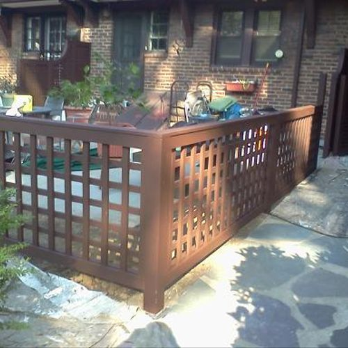 Tudor Brown fence in Forest Hills, NY.