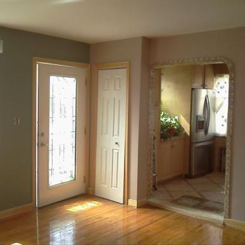 Two toned living room in New Hyde Park, Long Island with polyurethaned floors.