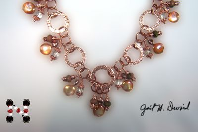 Copper metal work, kyanite, pearls-this one is full of movement.