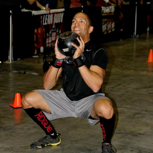 CrossFit Raid @ the Orlando Europa April 2012. 70# kettlebell squats. Form was flawless. Yours can be too!