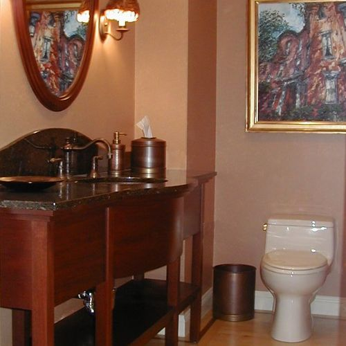 Custom designed cabinetry adds an air of elegance to this powder room.