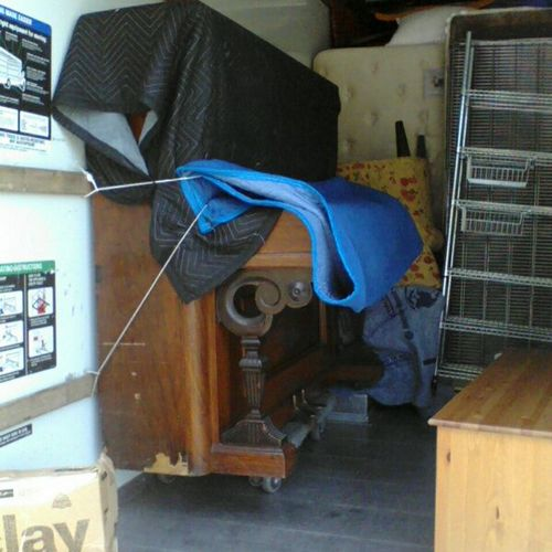 This Upright 950lb Grand Player Piano we moved up and down stairs with 4 movers. Secured nicely into truck in this photo.