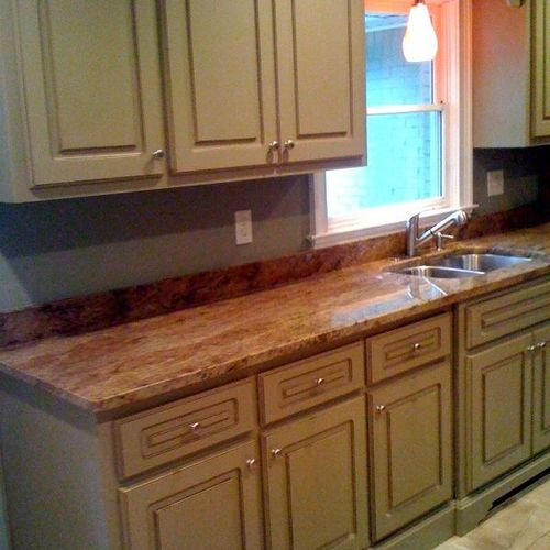 Custom Kitchen remodel with granite and custom tile