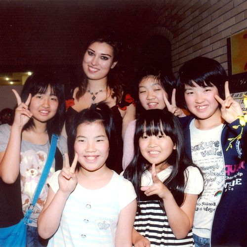 with fans after a concert in Japan