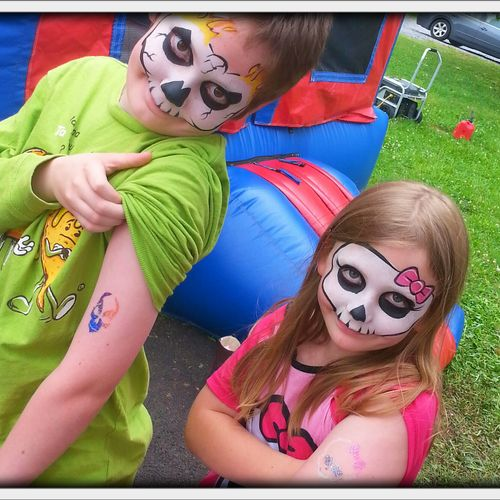 Twinsies! This brother and sister just love their face painting and glitter tattoos!