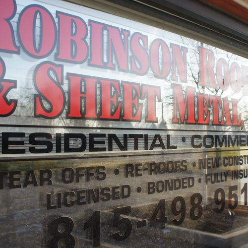 Store / Office Front Window - Robinson Roofing & Sheet Metal - DeKalb, DuPage, Kendall, Will and Kane County roofing services.