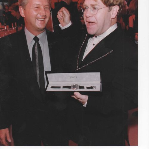 mixing and mingling with sir elton john at his oscar's party in hollywood.  a great time was had by all!