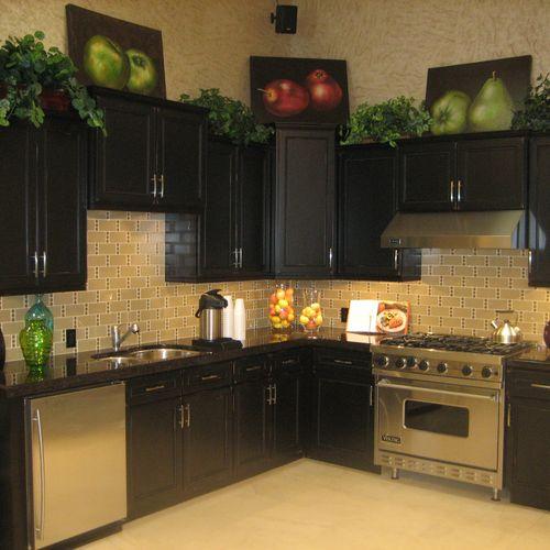 Arizona Tile (Rancho) Showroom. Maroon Cohiba Granite fabricated and installed by Stokes Granite & Stone, Inc.