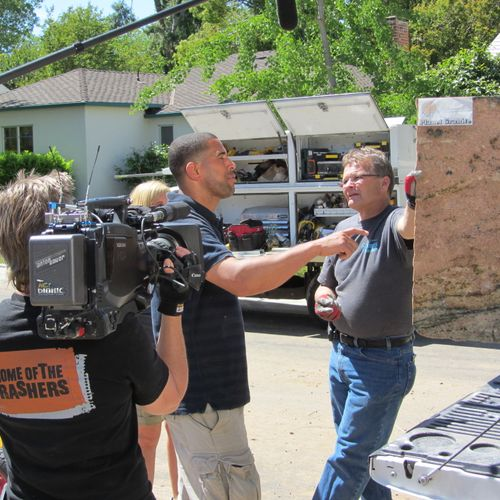 Ahmed of the DIY Networks Yard Crashers talking with Stokes Granite & Stone, Inc.'s owner, Mike Stokes.