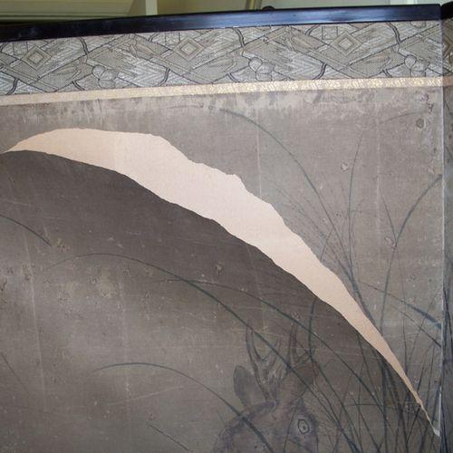 Close-up of torn paper screen
