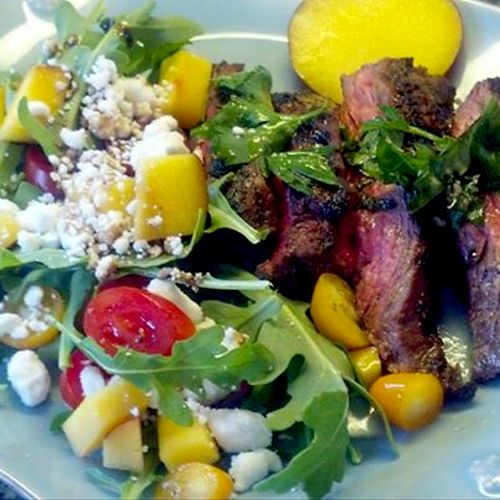 Florentine-Style Organic Grass-Fed Flat-Iron Steak with Basil, Parsley, Garlic and Rosemary - served with an Arugula, Goat Cheese, Georgia Peach and Heirloom Tomato Salad
